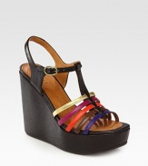 Flirty leather t-strap with a chunky wedge and adjustable multicolored straps. Self-covered wedge, 5 (125mm)Island platform, 1½ (40mm)Compares to a 3½ heel (90mm)Leather upperLeather liningRubber solePadded insoleMade in SpainOUR FIT MODEL RECOMMENDS ordering one half size up as this style runs small.