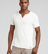 Split neck tee with eyelet details along the placket and tonal logo tab at the hem.