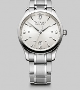 An elegant timepiece designed in polished stainless steel with a silver dial and renowned quartz precision. Round bezel Quartz movement Water resistant to 3 ATM Date function at 6 o'clock Second hand Stainless steel case: 45mm (1.77) Stainless steel bracelet: 28mm (1) Deployment clasp Imported