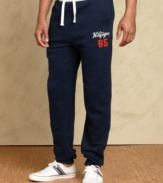 Cool casual comfort is easy to come by with these athletic pants from Tommy Hilfiger.