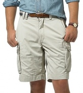 Plain front, relaxed fitting chino cargo shorts. Tightly woven cotton for style and durability. Soft washed for lived-in character and softness. Quarter top pockets and side cargo flap pockets offer cool, classic appearance. Relaxed, comfortable style. Pocket flaps feature taping detail. 8 inseam.