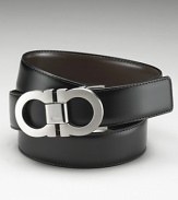 Salvatore Ferragamo classic Double Gancini reversible belt. Quintessentially classic and luxurious reversible leather belt with topstitching detailing and double-brushed buckle. Ferragamo is engraved on the buckle.