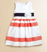A bright and cheery frock with colorful stripes and delicate flower is a seasonal go-to for day or night.CrewneckSleevelessBack buttonsWaistband with flower detail and back tie sashFull skirtCottonMachine washImported Please note: Number of buttons may vary depending on size ordered.