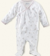 Ralph Lauren Childrenswear printed 2 piece set. An adorable kimono-style top and pant set in soft cotton jersey. Wrap top has long sleeves with fold-over detail. V-neckline with side ribbon tie. A single-snap closure at the hem. Ribbing at the neckline, placket and cuffs. Footed pant has elastic waistband and straight leg. Signature embroidered pony accents the chest.