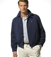 Classic fitting, zip-front windbreaker in high performance, sueded microfiber. Accented with tattersall cotton twill body lining. Buttoned throat latch, elastic waistband and buttoned cuffs. Slash pockets provide easy access and comfort. Inside pocket. Bi-swing construction for ease of movement. Polo's signature embroidered pony accents the chest.