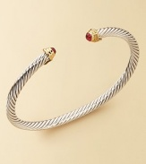 From The Cable Kids Collection. A charming sterling silver cable with ruby end caps set in 18k gold. Ruby Sterling silver and 18k yellow gold Cable, 4mm Diameter, about 2 Made in USA