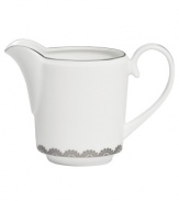 Vera Wang marries modern shapes with traditional lace in this set of dinnerware. The dishes are decidedly timeless. Platinum trim and banding add delicate feminine touches to this white bone china creamer.