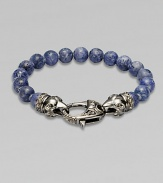 A new look for the modern man, handsomely crafted with a sterling silver raven's head clasp and a string of grey coral beads.Sterling silverLobster claspBracelet, 9 longAbout 3 diamImported