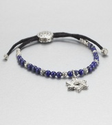 From the Batu Bedeg Collection. A beaded strand of carved silver and richly colored lapis is strung on a black fabric cord and highlighted by a stunning Star of David silver charm.LapisSterling silverAdjusts from about 6 to 9 longSliding bead closureMade in Bali