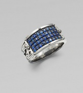 A tapered design in rhodium plated sterling silver is defined by four rows of tiny blue sapphires.Sterling silverBlue sapphiresAbout 1½ diamImported