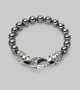 A new look for the modern man, handsomely crafted with a sterling silver raven's head clasp and a string of hematite beads. Sterling silver 10mm hematite beads Lobster clasp closure Bracelet, 9 long Imported