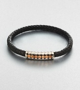 A simple design with modern sensibilities defines this woven leather bracelet, accented by a sterling silver and gold clasp.Sterling silver/GoldLeatherMagnetic claspAbout 3 diam.Imported