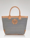 Tory Burch channels French chic with this roomy striped tote. Designed to be your new go-everywhere carryall in sturdy canvas with leather trims, it's sure to be the bag your reach for again and again.