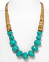 Tribal-inspired chic from RJ Graziano. This bold necklace marries graduated wooden discs with multifaceted turquoise beads for a versatile piece that works with a black dress or dark jeans.