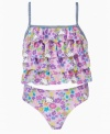 Do a little dance with ruffles. The layers on this tankini set from Hello Kitty make it a fun look to bring to the beach.