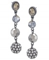 Long story. Four different versions of glass beads add a chic, complex element to these lovely linear drop earrings from Carolee. Crafted in hematite tone mixed metal, they'll look equally stylish for day or evening. Approximate drop: 2-1/4 inches.