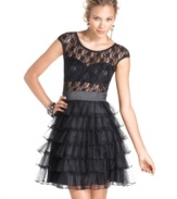 Roberta's update to the classic little black dress adds edge and flair with a chic lace top and sultry bustier! Chic ruffles at the skirt complete its hot look!