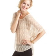 An airy, open-knit sweater that drapes the body in chic style! Jessica Simpson's high-low pullover brings a spirit of effortless cool to your favorite skinny jeans.