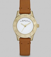 Simply chic timepiece with a luxuriously supple leather strap. Quartz movementWater resistant to 5 ATMRound goldtone stainless steel case, 26mm (1)Logo etched bezelWhite enamel dialSecond hand Tan leather strapImported