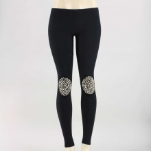 Stand out thanks to these stylish and chic leggings. Features a faux suede finish, elastic waistband and metal spike stud patches at the knees. 90% Polyester, 10% Spandex. Hand wash. Made in USA.